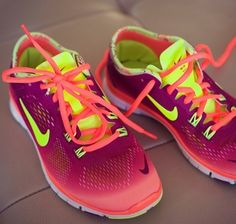 Pink ombré nike shoes so pretty and cute! Orange green and pink