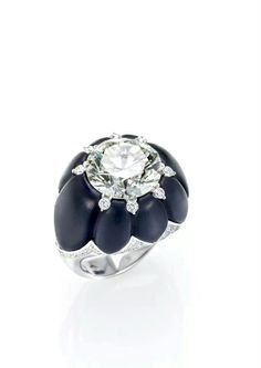 Onyx and diamond inlayd ring, by Bogh Art.