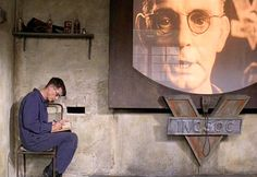 Winston Smith, hidden away from the eyes of the telescreen and writing in his…