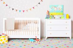 White crib and dresser in colorful child's room