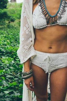 Sexy boho chic crochet bathing suit with modern hippie fringe style cover up & gypsy coin necklace & stacked bangle bracelets. For the BEST Bohemian fashion & Jewelry trends FOLLOW http://www.pinterest.com/happygolicky/the-best-boho-chic-fashion-bohemian-jewelry-gypsy-/