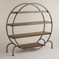 Round Bookcase | World Market - what an amazing price for such a cool piece...Anthropologie has one with a slightly different design for three times the cost!