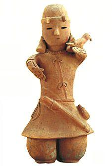 Man with hawk on arm. Kofun period art, Haniwa terracotta clay figure.   The 500s. Isezaki-city gunma Japan.