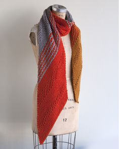 This big, lush scarf is an oversized treat! The Marmalade Dream is a bias knit scarf using Baa Baa Bulky yarn in three colors. Each color transition is worked over a simple lace stitch to give an interesting set of stripes. You'll love to cozy up in this dreamy shawl. #kitterly #kitterlykits #eweewe #knittingkits