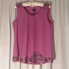 Silk and Sequin Blouse NWT Gorgeous sleeveless silk blouse with sequin detailing by Talbots.  Size 10.  Lovely mauve color.  Sequin detail continues completely around the hem.  100% silk. Talbots Tops Blouses