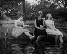 Three women keep cool during a heat wave by moving a park bench into the water in Central Park, New York. September 1961. via reddit