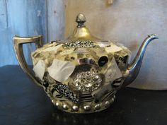 Mosaic silver plated teapot in black and white with vintage sparkly broach.