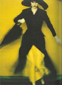 double-breasted coat dress in black silk satin, over a bra-dress in yellow silk satin spring–summer yohji yamamoto photography sarah moon Sarah Moon, Yohji Yamamoto, Look Fashion, Fashion Art, Editorial Fashion, Mellow Yellow, Black N Yellow, Black Silk, Color Yellow