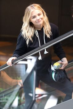 Chloe Grace Moretz shows off trim figure in a hoodie and leggings