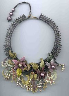 crafty jewelry: beaded flowers.   make handmade, crochet, craft couldn't find the name of the beader - Margo?