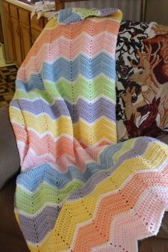 Rainbow Ripple Crochet Afghan (no pattern) (the white stripes between pastel rows really make the colours pop)