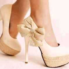 Cream high heels with bow