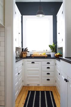 Small Kitchen Makeover Gorgeous white kitchen with pantry cabinets / design*sponge - Your home for all things Design. Home Tours, DIY Project, City Guides, Shopping Guides, Before Black Kitchens, Home Kitchens, New Kitchen, Kitchen Decor, Kitchen Ideas, Kitchen Small, Kitchen Pantry, Narrow Kitchen, Kitchen Black