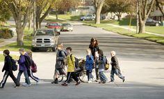 Walking School Bus Program coordinator Jane Dahlen escorts up to 10 children to Elton Hills Elementary each school day.