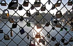 On Le Pont des Arts, lovers attach padlocks to seal their union.