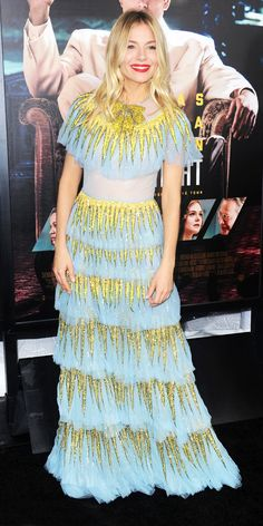 Look of the Day - Sienna Miller We had been waiting for a red carpet moment for this little Gucci number- a pastel blue tiered gown with a sequin bow patch at the neck and all-over shiny degradé patches and Sienna Miller got to wear it for the Live by Night premiere in Los Angeles.