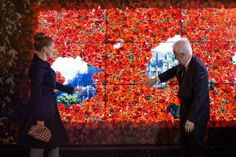 Gareries Lafyette's Interactive Fairy Tale Holiday Window Display. Passersby can touch to move the virtual red rose petals to reveal images behind.