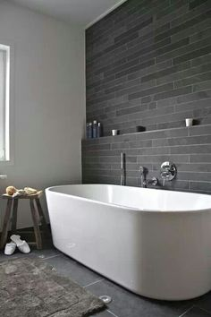 Back/window wall tile - accent wall in grey natural stone, smaller format either horizontal or herringbone