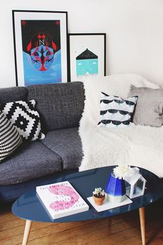 Design Sponge/ The sofa is Ikea and cushions are Ikea, HEMA, and homemade (available on my Etsy shop). The coffee table is AM PM. The porcelain vase is homemade (soon available in my Etsy shop). I bought the book Drawing by Ronan and Erwan Bouroulec during their retrospective at the Musée des Arts Décorative in Paris.