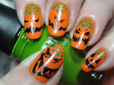 Don't normally dig nail art, but this is great! Mean pumpkins!