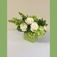 Green Glory  $90.00    Our trademark colors ! A lovely lime green and white combination with bells of Ireland, mojito hydrangea, berries and roses makes every space feel fresh and new.