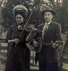 A couple playing fiddle and banjo