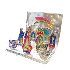 Do you like the idea of a portable, fold up, painted tin nativity scene? I do! This super ingenious nacimiento was handmade in Oaxaca and comes with the entire scene ready to go. When the season is ov