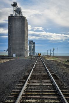 Deliverer - The siloes wait to be filled with wheat. The trains come and are loaded taking the grain throughout the world to be made in to  bread and other wheat products. With the farmers and trains...   This is in the foothills of the Blue Mountains of NE Oregon near Milton-Freewater, Oregon.