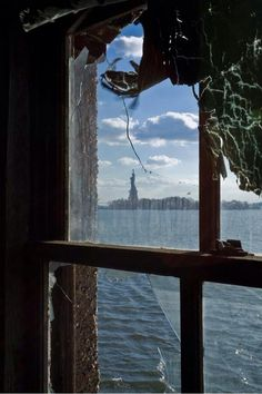 The Statue of Liberty, as viewed from the abandoned measles ward on Ellis Island