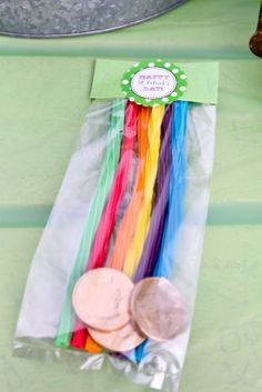 "Kids took home favor bags filled with rainbow Twizzlers and a few ""gold"" coins."