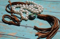 Hand-knotted creamy fresh water pearls are carefully knotted with chocolate brown waxed linen cording. Mix these luscious pearls with the softest