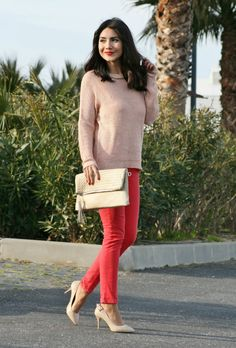 Shop this look on Lookastic:  https://lookastic.com/women/looks/pink-crew-neck-sweater-red-skinny-jeans-beige-pumps-beige-clutch/9383  — Pink Crew-neck Sweater  — Beige Leather Clutch  — Red Skinny Jeans  — Beige Leather Pumps