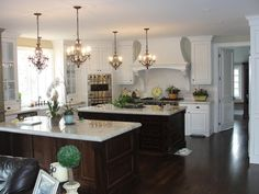 White kitchen, double islands, love the dark islands with white. love lights too