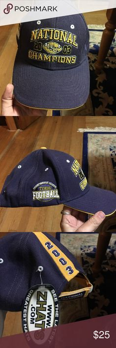 2003 National Championship LSU hat This has been in a box collecting dust for 13 years and I am moving internationally in a few months so looking to sell. Still has tags. never been worn. Zelcro adjustable. 35% wool 65% acrylic Zephyr Accessories Hats