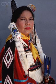 A Kiowa (First Nations) woman wearing a traditional dress decorated with beadwork, a necklace of bone beads and hair ornaments of rabbit fur and beadwork. Native American Images, Native American Beauty, American Indian Art, Native American Tribes, Native American History, American Indians, American Girls, Indiana, Into The West