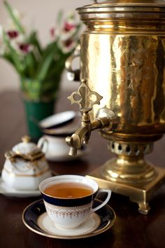 'samovar'. a samovar is a heated metal container traditionally used to heat and boil water in and around Russia.