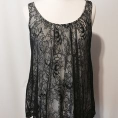 "Black and White Lace Overlay Top Updated classic! Black lace overlay, white knit tank. Flattering A-line silhouette. 100% viscose Hand wash 40"" bust 26"" overall length Cable & Gauge Tops Tank Tops"