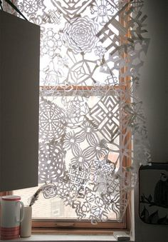 By collaging together a hodgepodge of uniquely-shaped snowflakes, Design Sponge assembled a pretty paper window curtain.