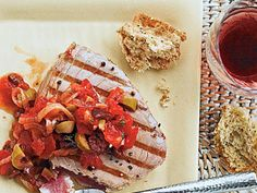 Grilled Tuna with Mediterranean Sauce | The robustly flavored sauce gets its inspiration from olives, tomatoes, and fresh thyme, but is simple to prepare. When the topping is this bold, go with a simple grilled technique for the fish.