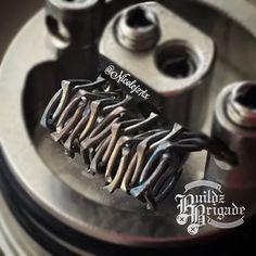 Boneyard coil.. 2x26g Nichrome twisted clockwise 2x26g Nichrome twisted counter clockwise. Then both strands hammered out flat. .29ohms