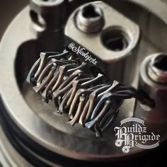 Boneyard coil….. 2x26g Nichrome twisted clockwise 2x26g Nichrome twisted counter clockwise. Then both strands hammered out flat. .29ohms