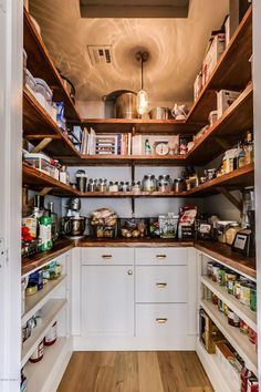 """Traditional Pantry with American 5"""" Solid Oak Hardwood Flooring in Gunstock by Armstrong, Built-in bookshelf, Pendant Light"""