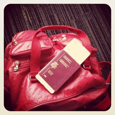 ...never travel without my Kipling bag. Can't ever go wrong with bright red!