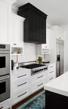 There is no question that designing a new kitchen layout for a large kitchen is much easier than for a small kitchen. A large kitchen provides a designer with adequate space to incorporate many convenient kitchen accessories such as wall ovens, raised. Refacing Kitchen Cabinets, Kitchen Countertops, White Cabinets, Base Cabinets, Cupboards, Black Kitchens, Cool Kitchens, Dream Kitchens, Kitchen Hoods