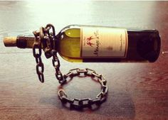 Industrial Chain Wine Holder- Raw finish by ZHfabrications on Etsy https://www.etsy.com/listing/248414636/industrial-chain-wine-holder-raw-finish