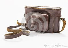 Leather package on the analog camera on white background.