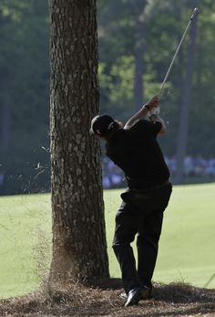 Phil Mickelson - 2010 Mickelson's tee shot on the par-5 13th lands right of the fairway. With a two-shot lead, he has to decide whether to go for the green or play safe. THE SHOT: Mickel-son's ball comes to rest on pine straw, but he has a gap between two pine trees. He selects a 6-iron for the 207-yard shot and executes it perfectly. The ball clears the tributary of Rae's Creek and settles a few feet from the pin. He misses the eagle putt, but the birdie locks up the victory.