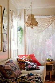 Use a Shawl Vintage shawls, like e mbroidered piano shawls and macrame shawls make stunning bed canopies, window covers and even bedcovers. The long fringe just makes a room feel whimsical and homey.