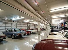 Feel the need for speed? A 22 car garage is just the place to showcase flashy hot rods. #cars #mancaves