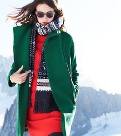 winter layers: red dress + green coat + snuggly scarf